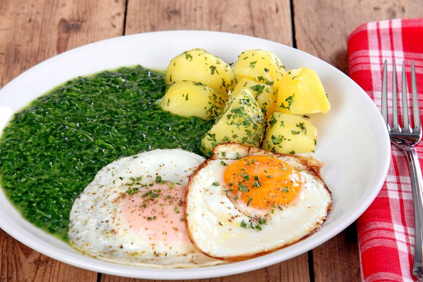 German spinach, fried eggs and potatoes